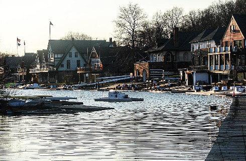 Row of homes and boat docks lining a narrow river